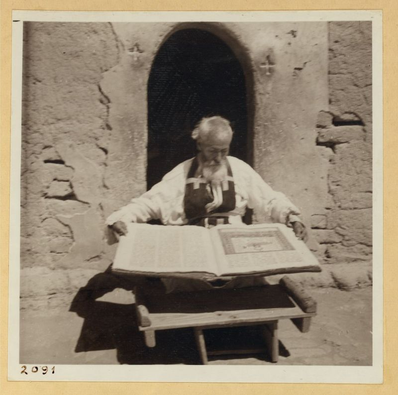 [Priest and His Prized Manuscript Bible]