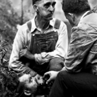 [Sheriff Jack Laxton Administers Oxygen to Rescue Worker Edker Hunnicutt]